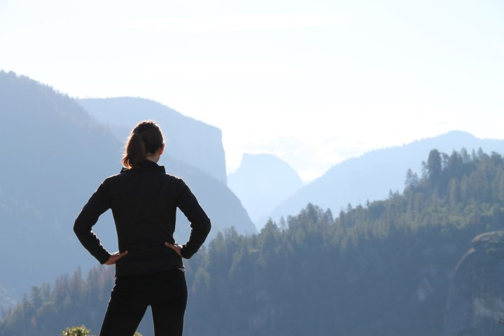 woman standing looking over mountains